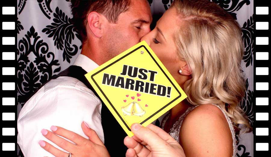 Glam Photobooths Bride and Groom kissing in our Classic Photo Booth
